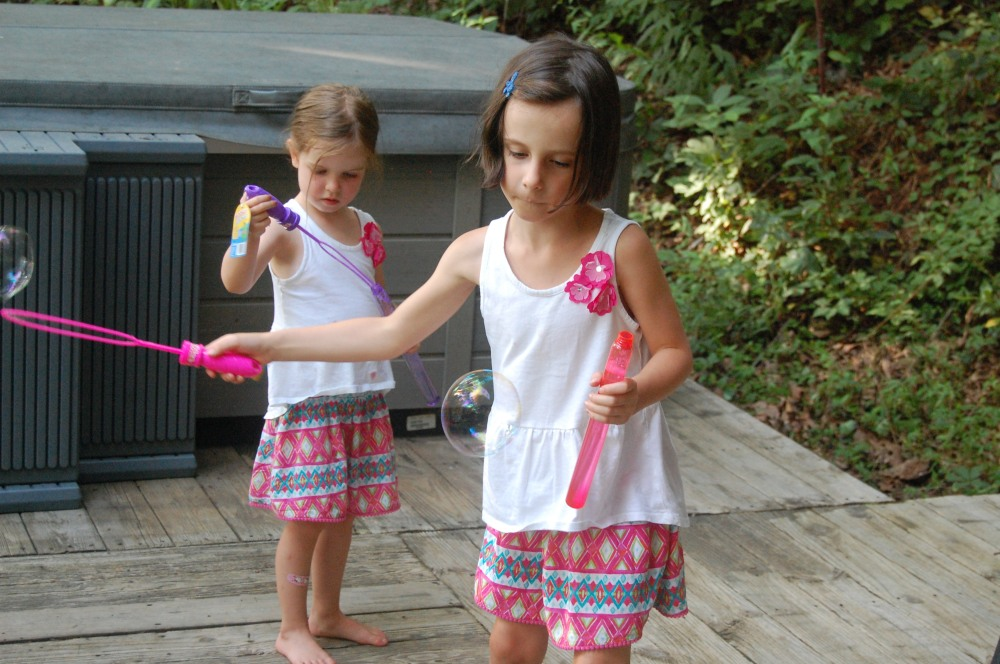 The girls blow bubbles on a recent trip to Asheville while Nate & I dream about the future